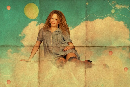 beauty young woman with book in clouds photo