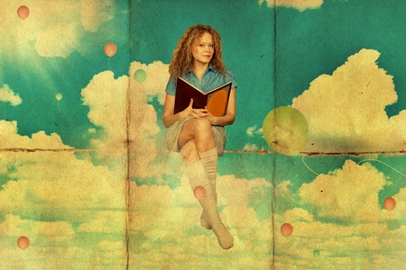 beauty young woman with book on clouds, vintage photo