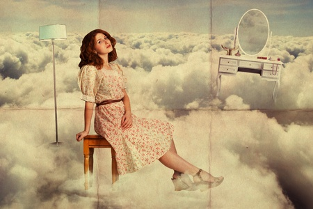 art collage. beauty young woman on sky in the clouds photo