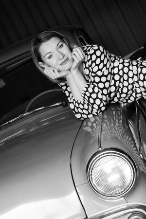 desatirated photo of beauty young woman with vintage car photo