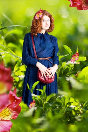 dyllic: beauty woman in a green grass in blue dress, on nature Stock Photo