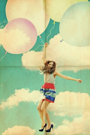 beauty young woman on balls in sky photo