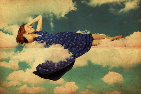 beautiful young woman in clouds in the sky Stock Photo - 9775081