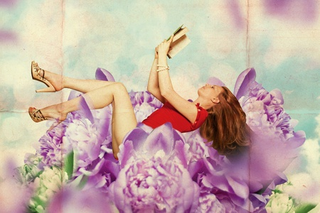 beautiful woman with book in fairy flowers photo