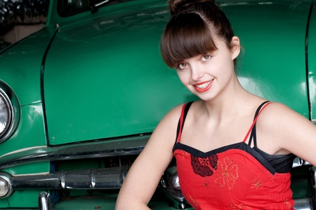 beauty young woman with green retro car, vintage photo