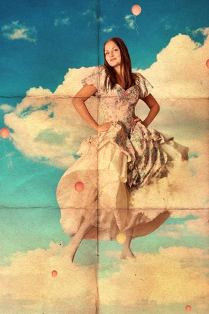 beauty young woman in pretty dress on clouds, vintage photo