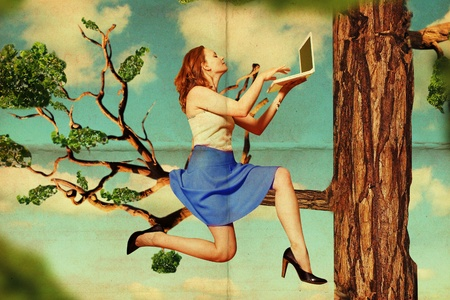 beautiful woman on tree with laptop, vintage pattern