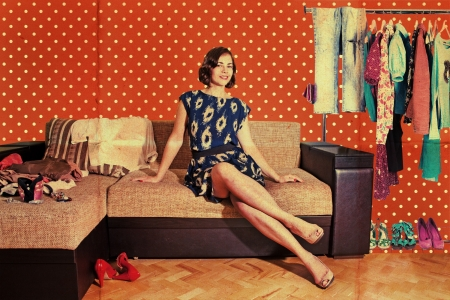 beautiful woman in retro room with fashion clothes, vintage pattern