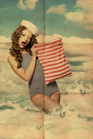 pinup: art collage with woman in the sea