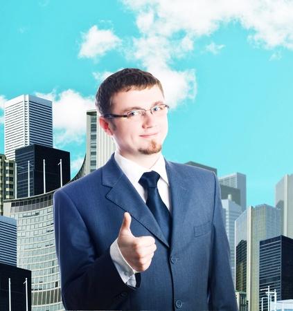Happy business man in suit, outdoor photo