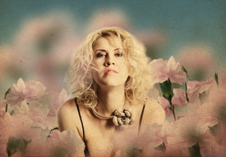 art collage with very beautiful woman in flowers  photo