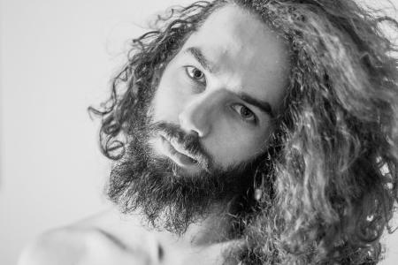 long beard: art portrait of handsome man, desaturated