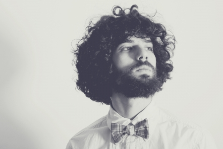 man with long hair: portrait of handsome man with bow-tie Stock Photo