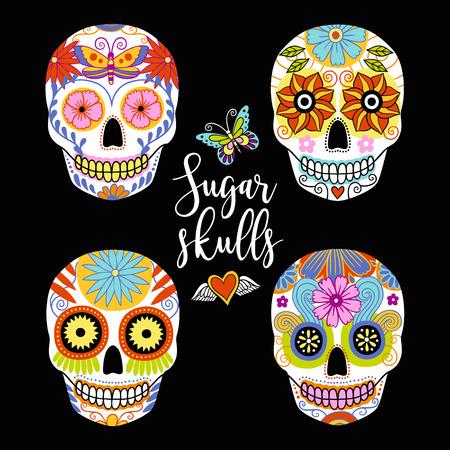 Vector set of hand drawn colorful traditional mexican sugar skulls.