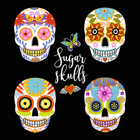 Vector set of hand drawn colorful traditional mexican sugar skulls.