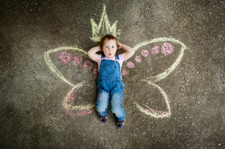Little Fairy girl surprise drawing with chalk on the pavement