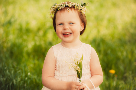 beautiful girl with a bouquet of lilies of the valley photo