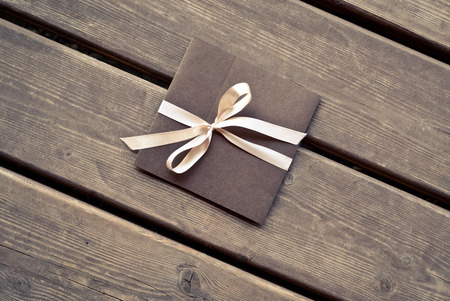 envelope: Gift envelope on the wooden floor