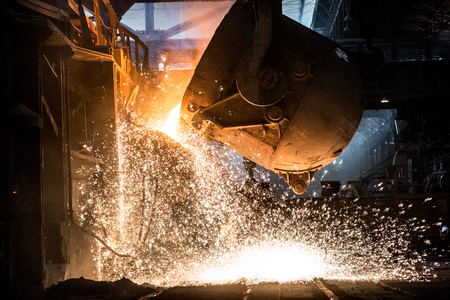 burningout: Pouring of liquid metal in open-hearth furnace Stock Photo