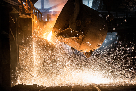smelting plant: Pouring of liquid metal in open-hearth furnace Stock Photo
