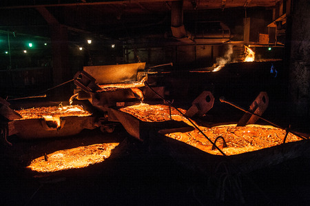 ferrous foundry: Pouring liquid titanium slag from arc furnace Stock Photo