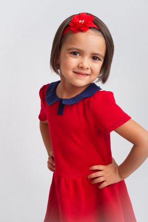 Beautiful little Girl smiling in red dress Stock Photo