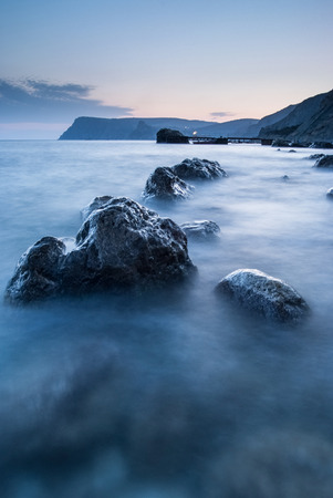 ultramarine: Stones in the sea on a long exposure