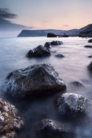 ultramarine blue: Stones in the sea on a long exposure