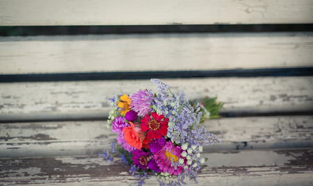 wooden surface: bouquet flowers on the wooden background Stock Photo