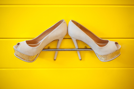 no heels: Womens wedding shoes on a yellow background