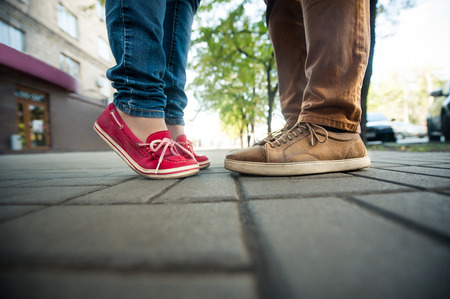 fashionable couple: love couple standing on the sidewalk, Legs man and woman Stock Photo