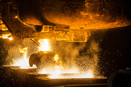 ferrous foundry: Tank pours the liquid steel in the molds Stock Photo