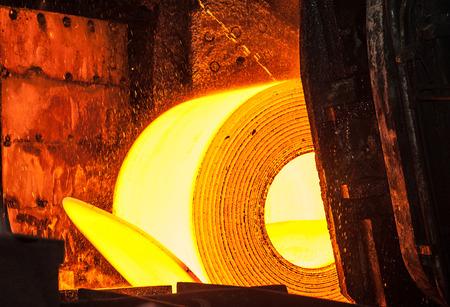 ferrous foundry: Roll of hot steel on the conveyor belt Stock Photo