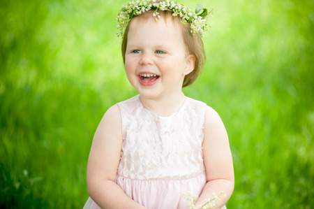 chuckle: funny baby girl smiling outdoors Stock Photo