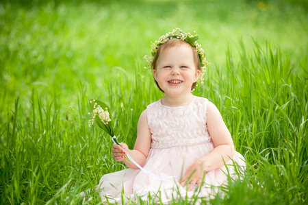 unruly: funny baby girl smiling outdoors Stock Photo
