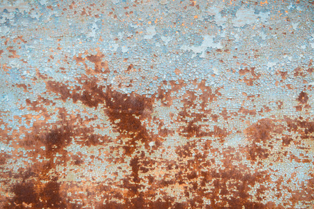 worn structure red: Old rusty metal wall with blue peeling paint