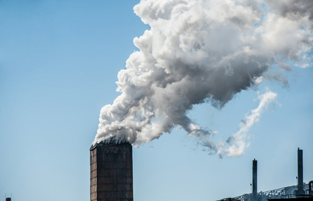 polluting: Smoke from a pipe factory polluting air, environmental problems Stock Photo