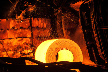 ferrous foundry: Roll of hot metal on the conveyor line