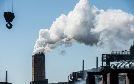 Smoke from a pipe factory polluting air, environmental problems Standard-Bild