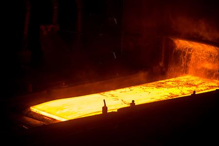 ferrous foundry: Sheet of hot metal on the conveyor belt