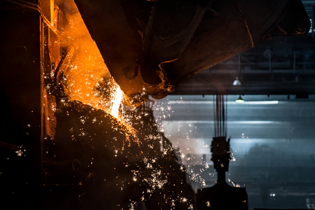 ferrous foundry: Pouring of liquid metal in open-hearth furnace Stock Photo