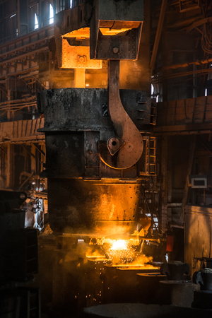 steelmaker: Tank pours the liquid steel in the molds Stock Photo