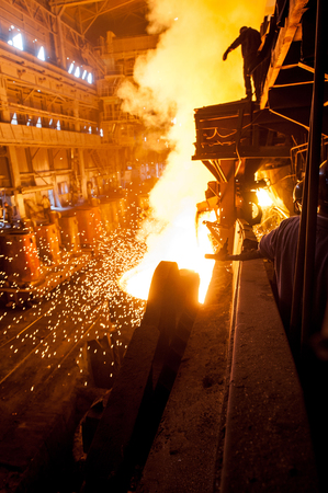 ferrous foundry: Steelworker near the tanks with hot metal