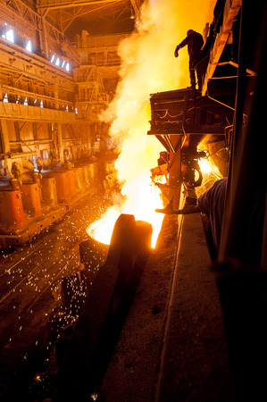 steelmaker: Steelworker near the tanks with hot metal