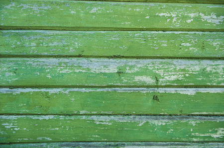 painted wood: Old weathered wood planks painted in green.