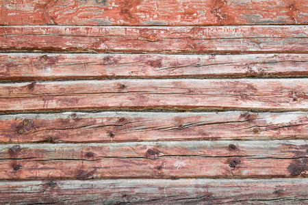 worn structure red: Old weathered wood planks painted in red Stock Photo