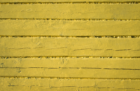 painted wood: Old weathered wood planks painted in yellow
