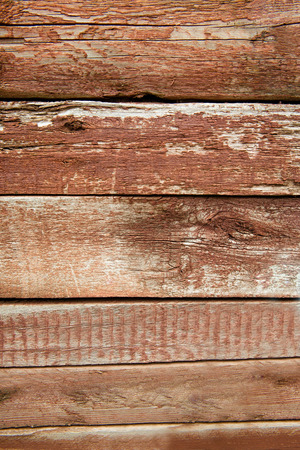 painted wood: Old weathered wood planks painted in red Stock Photo