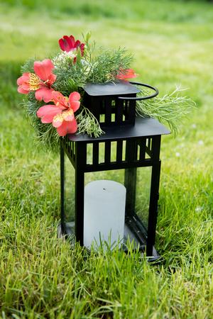 Beautifully decorated outdoor hanging lantern. Wedding decor.