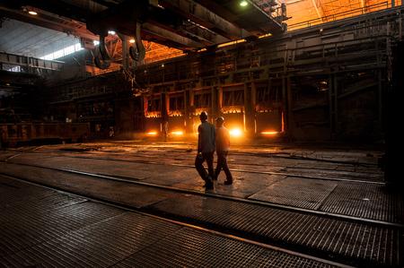 steelmaker: Steelworkers near the working open hearth furnace Stock Photo